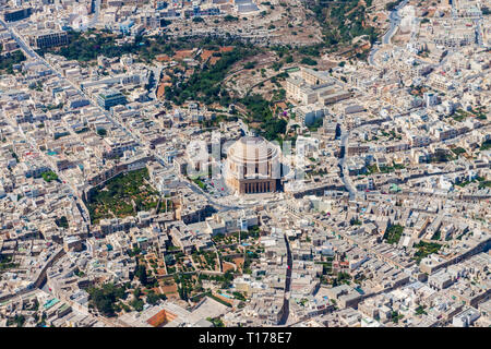 Famous Mosta Dome, Rotunda of Mosta, The Basilica of the Assumption of Our Lady Mary aerial view. Roman Catholic parish church and Minor Basilica. - Stock Image