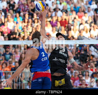 Ostrava, Czech Republic. 01st June, 2019. L-R David Schweiner (Czech) and Alison (Brazil) are seen in action during the four-star J&T Banka Ostrava Beach Open 2019, part of the FIVB Beach Volleyball World Tour, in Ostrava, Czech Republic, on July 1, 2019. Credit: Vladimir Prycek/CTK Photo/Alamy Live News - Stock Image