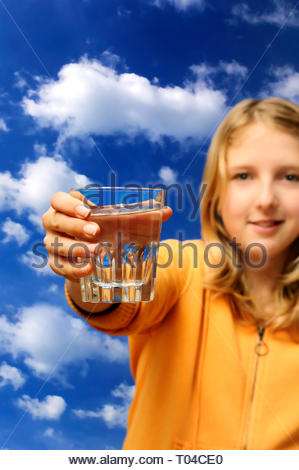 blond girl showing a glass of clean water - Stock Image