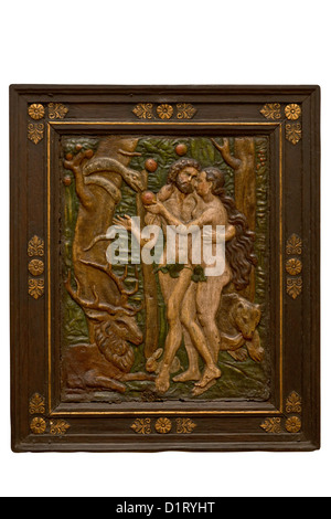 Old wood carved image of Adam and Eve in the Garden of Eden - Stock Image