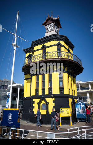 The clock tower at the V&A Waterfront on Cape Town, South Africa. Painted yellow for 2014 instead of the normal - Stock Image