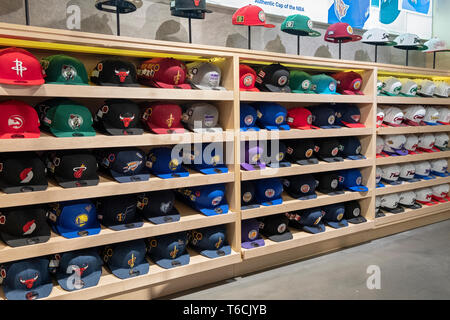 A wide variety of team caps for sale inside the NBA store on Fifth Ave. in Midtown, Manhattan, New York City. - Stock Image