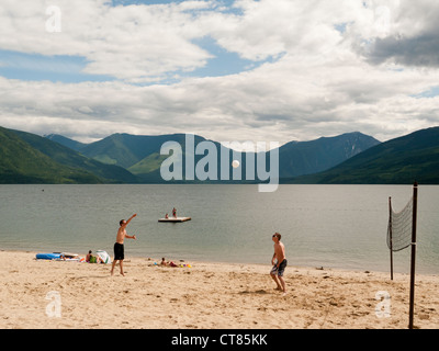 People on the beach in Nakusp on Upper Arrow Lake in British Columbia in Canada - Stock Image