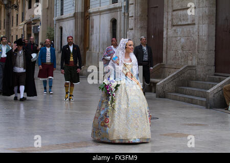 Flower offering procession honouring the holy Lady of Valencia during Fallas Festival, Valencia Spain - Stock Image