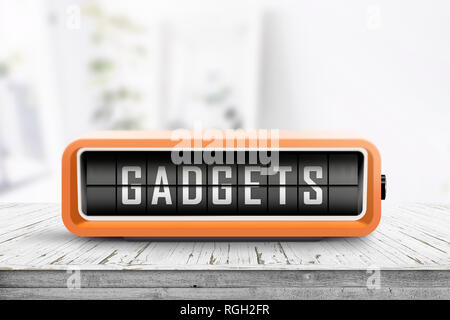 Gadgets sign on a table with a retro alarm clock in a bright home - Stock Image