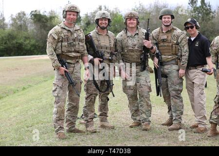 Colorado Army National Guard Soldiers place 2nd at the U.S. Army Small Arms Championships at Fort Benning, Georgia March 10-16, 2019. Team members are: Staff Sgt. Micah Fulmer, Sgt. 1st Class Christopher Catlin, Sgt. Shane Davis, and Sgt. Michael Kienbusch.    The annual, week-long competition that is hosted by the U.S. Army Marksmanship Unit is the Army's premier marksmanship competition that tests Soldiers on both their primary and secondary weapons through 11 different courses of fire. - Stock Image