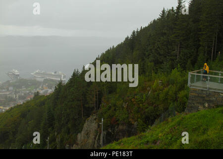 Bergen, Norway - 9 August 2018: A tourist seen at the summit of the  Mount  Floien funicular in Bergen, Norway's second largest city.  The funicular acends  320 meters above the city in just about 5 minutes.  The city was for many years the centre of trade between Norway and the rest of Europe and is now usually the starting point to  expeditions into the country. The 900 year old city steams its roots from the Viking age,  with Bryggen (The Hanseatic Wharf) being a remenant from this times and it today home to many of the cities restaurants, pubs, craft shops and museums. Photo: David Mbiyu - Stock Image