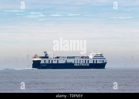 Crosby, Merseyside. 20th March, 2019. Warm hazy spring day at the coast as coastal vessel SEATRUCK heads into the Irish sea. Credit: MWI/AlamyLiveNews - Stock Image