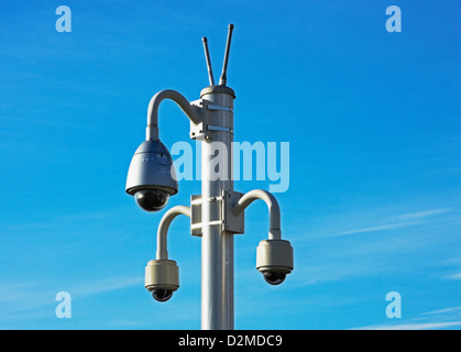 overhead lights with security camera - Stock Image