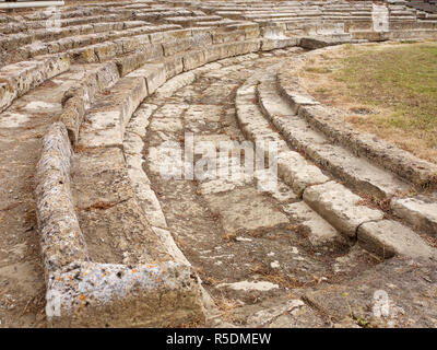 Remains of a semi circular amphitheatre at Metaponto Archaeological Park, Province of Matera, Italy - Stock Image