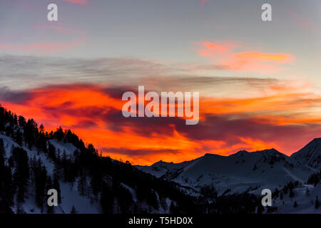 Flaming red skies at sunset over Obertauern, Austria - Stock Image