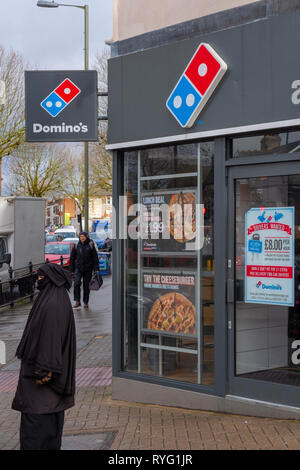 An advertisement offering work for drivers is pasted to the door of a Domino's pizza store in East Finchley, London. In December 2018 UK unemployment  - Stock Image