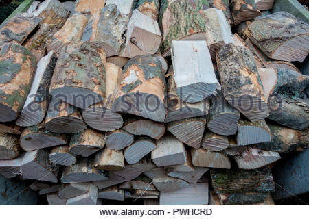 Ready for the log burner, cut and seasoned hardwood, neatly stacked. - Stock Image