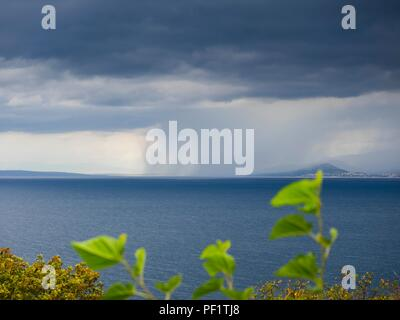 Threatening dark sky before storm or thunderstorm rain in distance - Stock Image