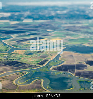 Aerial View of a River Passing Through Farmland - Stock Image