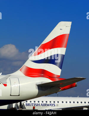 British Airways tail fin plane logo and blue sky - Stock Image