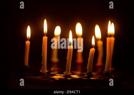 Birthday Cake Candles on a chocolate cake - Stock Image