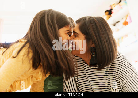 Affectionate mother and children rubbing noses - Stock Image
