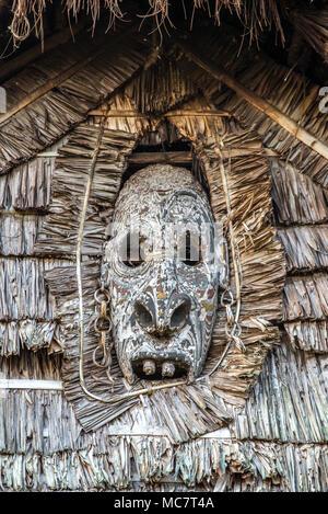 A wood carved mask Haus Tambaran (men's or spirits house) of Kaminibit village, East Sepik Province, Papua New Guinea - Stock Image