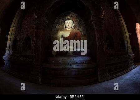 Temple interior with Buddha effigies, Bagan, Myanmar - Stock Image