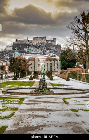 Gardens of Mirabell Palace or Schloss Mirabell in a snow day, Salzburg, Austria - Stock Image