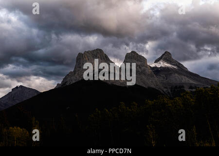 Breathtaking view of the famous Canadian Rockies Three Sisters Mountain peaks, Canmore Alberta Canada - Stock Image
