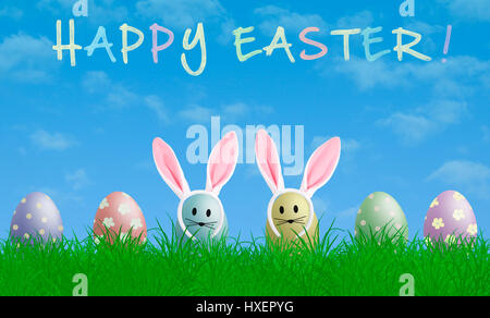 colorful pastel easter eggs with bunny ears in grass with blue sky background and text happy easter - Stock Image