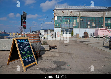 Mikkeller craft beer, tasting room and back garden pub on Refshaleøen, Copenhagen, Denmark, close to the Reffen Street Kitchen, in early season. - Stock Image