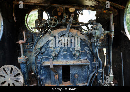 Steam locomotive cab controls and firebox of State Saw Mills steam engine SSM No. 2, slowly rusting away in a rail museum in Pemberton, Western Austra - Stock Image