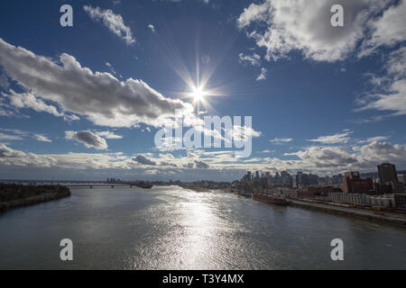 MONTREAL, CANADA - NOVEMBER 8, 2018: Molson Brewery & a cargo ship in the industrial port of Montreal, Quebec, with the skyline and center business di - Stock Image