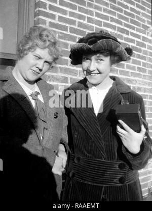 Two women pose together against a brick wall,ca. 1928. - Stock Image