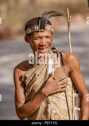 Erindi, Namibia / July 19, 2018: A native bushman gives a farewell dance to wish good hunting to the photographers in Botswana - Stock Image