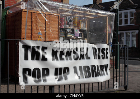 Sign hanging outside Kensal Rise temporary library in London opposing change - Stock Image