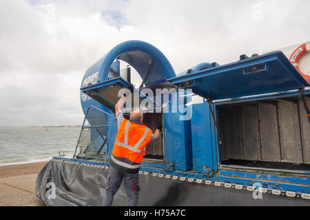 PORTSMOUTH, UNITED KINGDOM - AUGUST 28TH 2016: An engineer inspects the engines of a Hovercraft boat before it departs - Stock Image