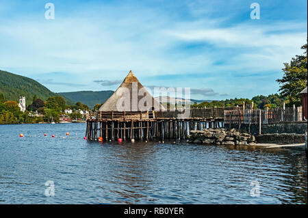 Early iron age Scottish Crannog Centre on Loch Tay near Kenmore Scotland as seen from the western loch shore - Stock Image
