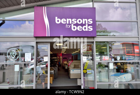 Exterior of retail Bensons for Beds bedding store in retail park with displays of beds, UK - Stock Image