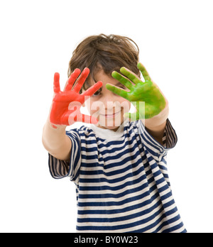 young boy with hands painted in red and green - Stock Image