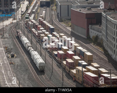 MONTREAL, CANADA - NOVEMBER 8, 2018: Railyard with container trains and wagons standing in the industrial port of Montreal in Quebec, one of the main  - Stock Image