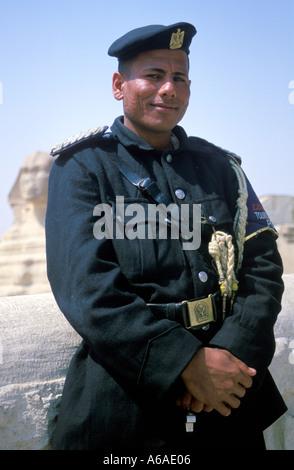 Egypt Cairo Giza Tourist Policeman - Stock Image
