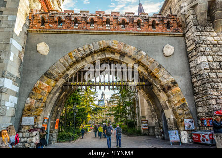 Tourists and local Hungarians enter Vajdahunyad Castle in the City Park of Budapest, Hungary, built in 1896 as part of the Millennial Exhibition. - Stock Image
