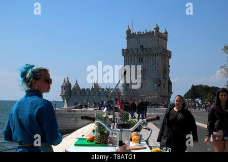 Young woman entrepreneur selling fresh squeezed orange juice to tourists at outside Belem Tower Belem, Lisbon Portugal Europe EU  KATHY DEWITT - Stock Image