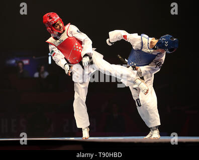 Iran's Mahla Momenzadeh (left) on her way to winning her semi final of the Women's -46kg against China's Xueqin Tan, during the World Taekwondo Championships at Manchester Arena. - Stock Image