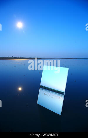 Reflection on a large crystal during the twilight in the natural park of Las Lagunas de Villafafila. zamora. Spain - Stock Image