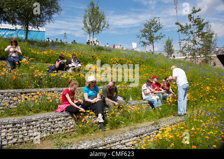 People sitting in Great British Garden at Olympic Park, London 2012 Olympic Games site, Stratford London E20 UK, - Stock Image