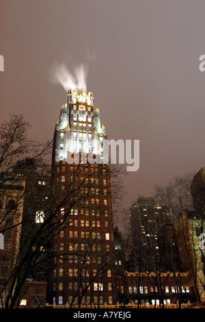 Skyscraper illuminated at night, New York, NY, USA - Stock Image