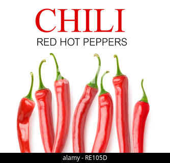 Isolated peppers. Fresh red hot chili peppers in a row with copy space isolated on white background with clipping path - Stock Image