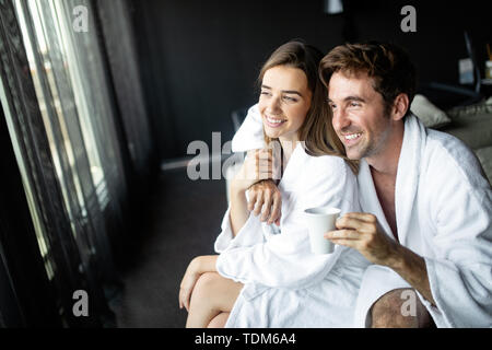 Cheerful young couple in the morning at home. - Stock Image