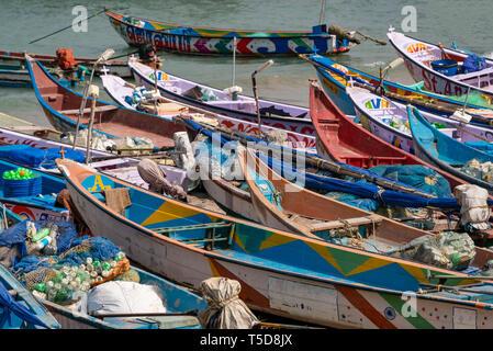 Horizontal view of colourful fishing boats on the beach in Kanyakumari, India. - Stock Image