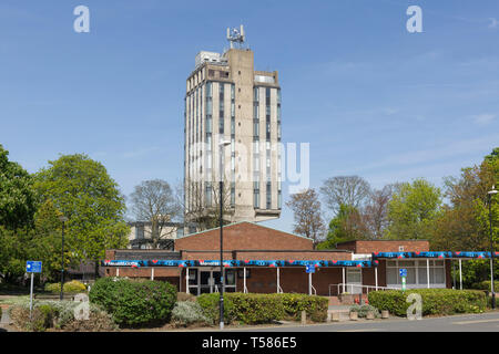 The former Wrexham police head quarters building towering above the memorial hall in Bodhyfryd Wrexham. The police station closed in January 2019. - Stock Image