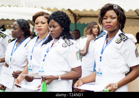 Abidjan, Ivory Coast - August 3, 2017: Epaulette and graduation ceremony for students leaving the Maritime Academy. group of marine women dressed in w - Stock Image